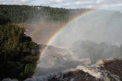 Rainbow over Argentinian iguazu. Waterfalls Royalty Free Stock Images