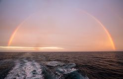 Rainbow over Atlantic ocean after heavy storm stock image