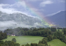 Rainbow over Austrian Alps Stock Photography