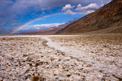 Rainbow over Badwater. Scenic view of rainbow over Badwater in Death Valley National Park, California, U.S.A Stock Images