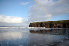 Rainbow over the ballybunion cliffs Stock Photos