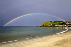 Rainbow over Ballygally. Antrim County, Northern Ireland stock photos