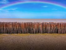 Rainbow over Bamboos at Low Tide stock image