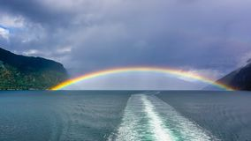 Rainbow over the bay of Sognefjord, Norway stock photography