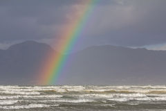 Rainbow over Beach. On rainy day at Muizenberg, Cape Town, South Africa Royalty Free Stock Photos