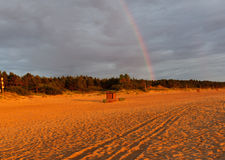 Rainbow over a beach Royalty Free Stock Images