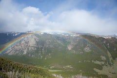 Rainbow Over Beartooth Pass. A rainbow spanning the mountains of Beartooth Pass stock image