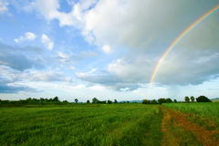 Rainbow. The rainbow over a beautiful meadow in spring Stock Photo