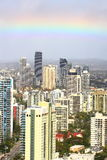 Rainbow over towers aerial image Royalty Free Stock Image
