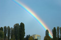 Rainbow over block of flats Royalty Free Stock Photography