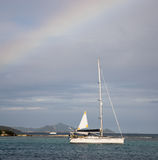 Rainbow over boat in the caribbean Royalty Free Stock Photos