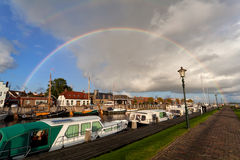 Rainbow over boat at Zoutkamp harbor Royalty Free Stock Images