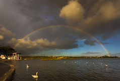 Rainbow over the boating lake in Poole Park Stock Photography