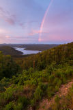 Rainbow Over Broken Bow Lake. A rainbow in the sky during a beautiful sunset at Broken Bow Lake, Oklahoma Royalty Free Stock Image