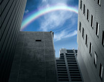 Rainbow over the building. Rainbow in the sky mean new hope Royalty Free Stock Image