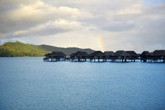 Rainbow over the Bungalows Stock Images