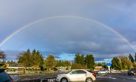 Rainbow Over Burien. A rainbow arcs over Burien, Washington stock image