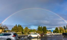 Rainbow Over Burien 2. A rainbow arcs over Burien, Washington royalty free stock image