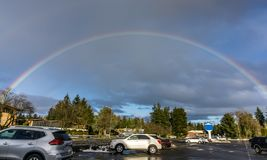 Rainbow Over Burien 3. A rainbow arcs over Burien, Washington royalty free stock image