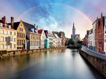 Rainbow over Canal in Bruges and famous Belfry tower,  Belgium Royalty Free Stock Photo