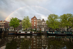 Rainbow over canal Stock Photos