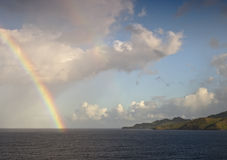 Rainbow over caribbean sea Stock Image