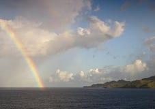 Rainbow over caribbean sea. Landscape Stock Image