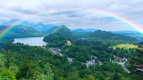 Rainbow over castle in Bavaria Royalty Free Stock Photo