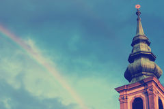 Rainbow over the church Stock Photography