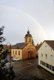 Rainbow over the church Royalty Free Stock Images