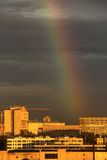 Rainbow over the city. Bright rainbow over the evening city. Moscow Stock Photo
