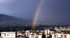 Rainbow over the city. Colorful rainbpw over the city Nitra in Slovakia near the hill ad castle Royalty Free Stock Photography