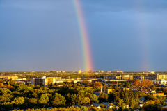 Rainbow over the city. Aerial view at the Winnipeg city during rainbow after rain Stock Image