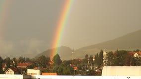 Rainbow over City stock video