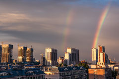 Rainbow over the city Stock Images