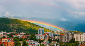 Rainbow over the city of Budva Stock Photo