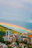 Rainbow over the city of Budva Stock Photos