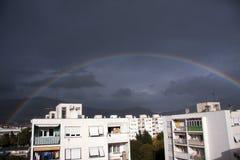 Rainbow Over City Stock Image
