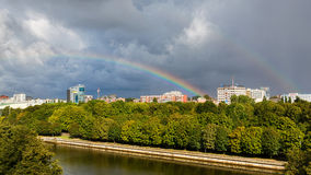 Rainbow over the city Stock Photos