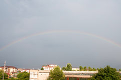 Rainbow over the city Stock Image