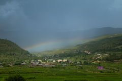 Rainbow over the city, paro, bhutan Royalty Free Stock Images