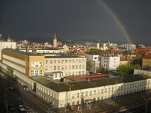 RAINBOW OVER THE CITY stock photography