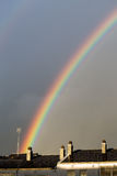 Rainbow over city roofs Stock Photography