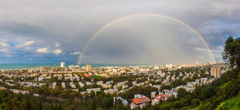 Rainbow over the city after a spring rain Royalty Free Stock Photo