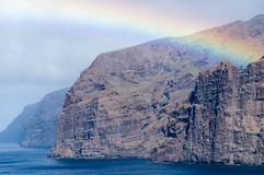 Rainbow over cliffs of Los Gigantes, Tenerife Royalty Free Stock Photography
