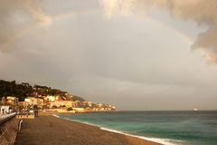 Rainbow over coast Stock Photography
