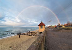 Rainbow over the coast of Baltic Sea Stock Photos