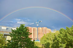 Rainbow over construction site Stock Image