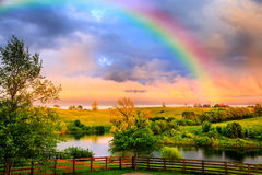 Rainbow over countryside stock image