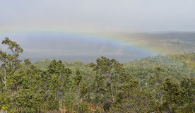 Rainbow over the crater in Volcanoes National Park, Big Island of Hawaii Royalty Free Stock Image